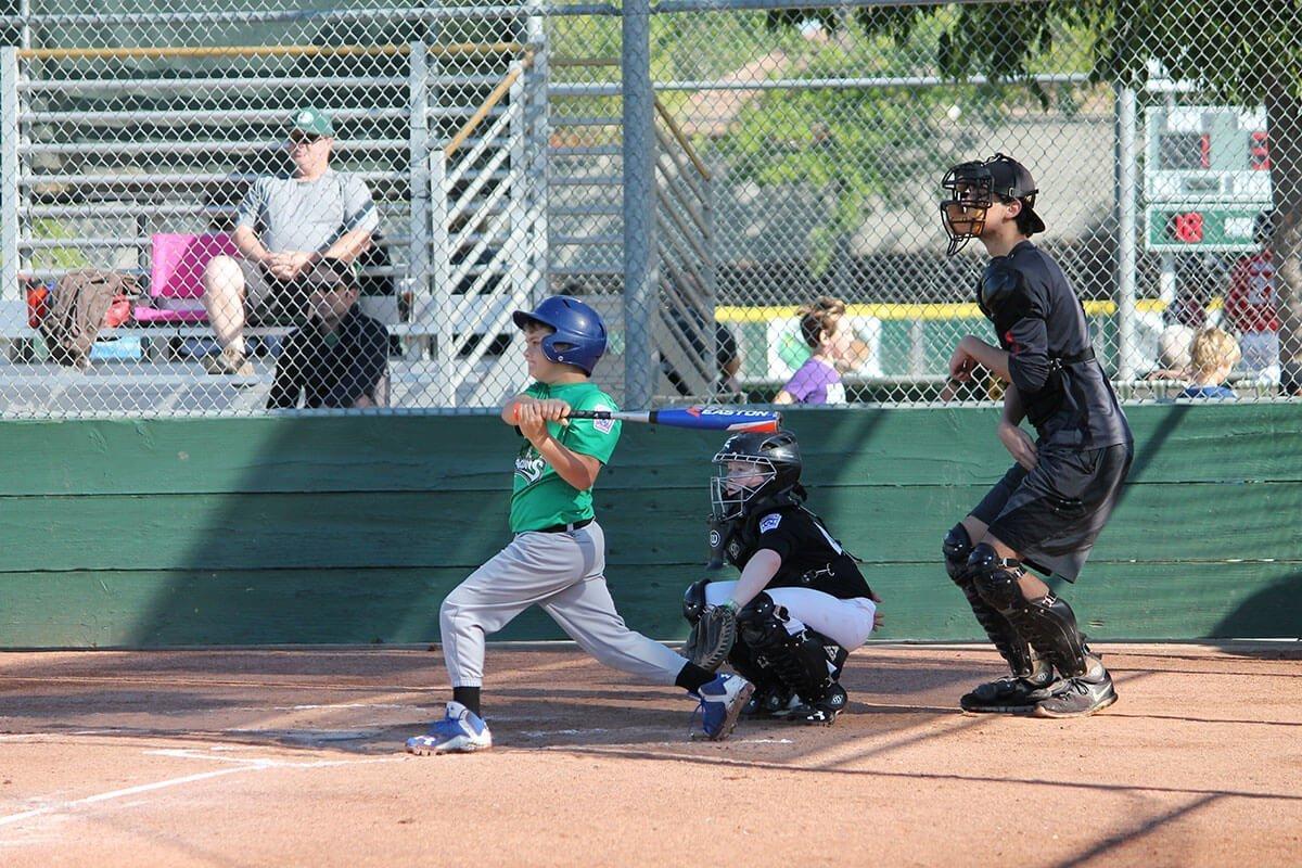 Dragons Little League batter hits home run