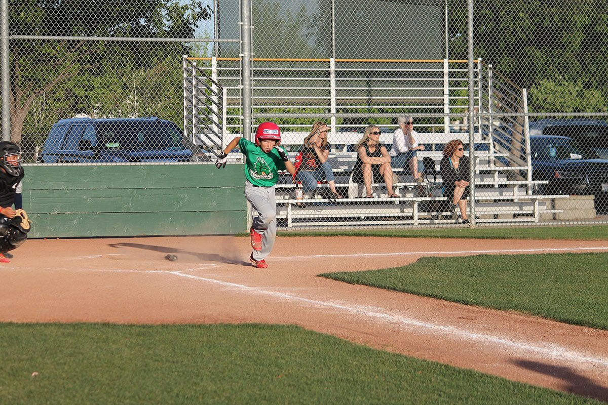 Lakeside Little League Dragons player running
