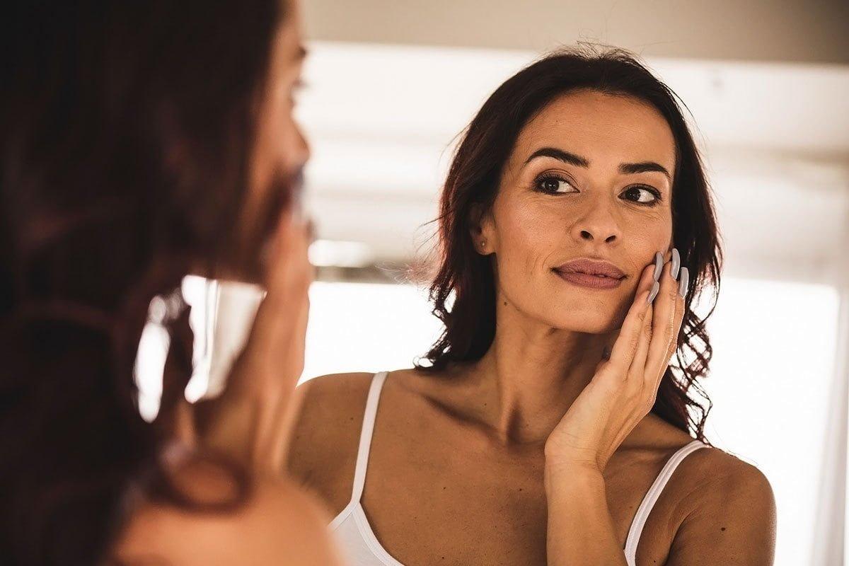 woman considers facial rejuvenation facelift mini facelift brow lift at granite bay cosmetic surgery