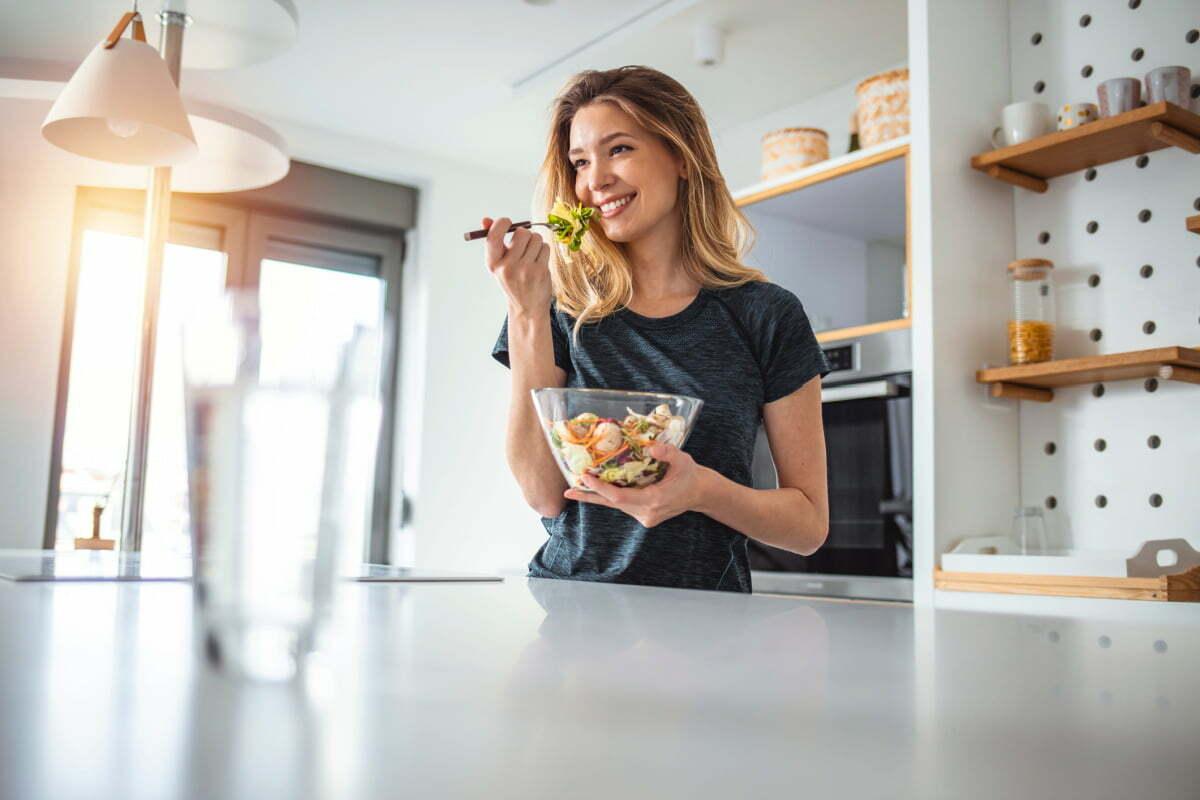 Woman Enjoying Salad as part of Nutritious Diet Pre-Surgery